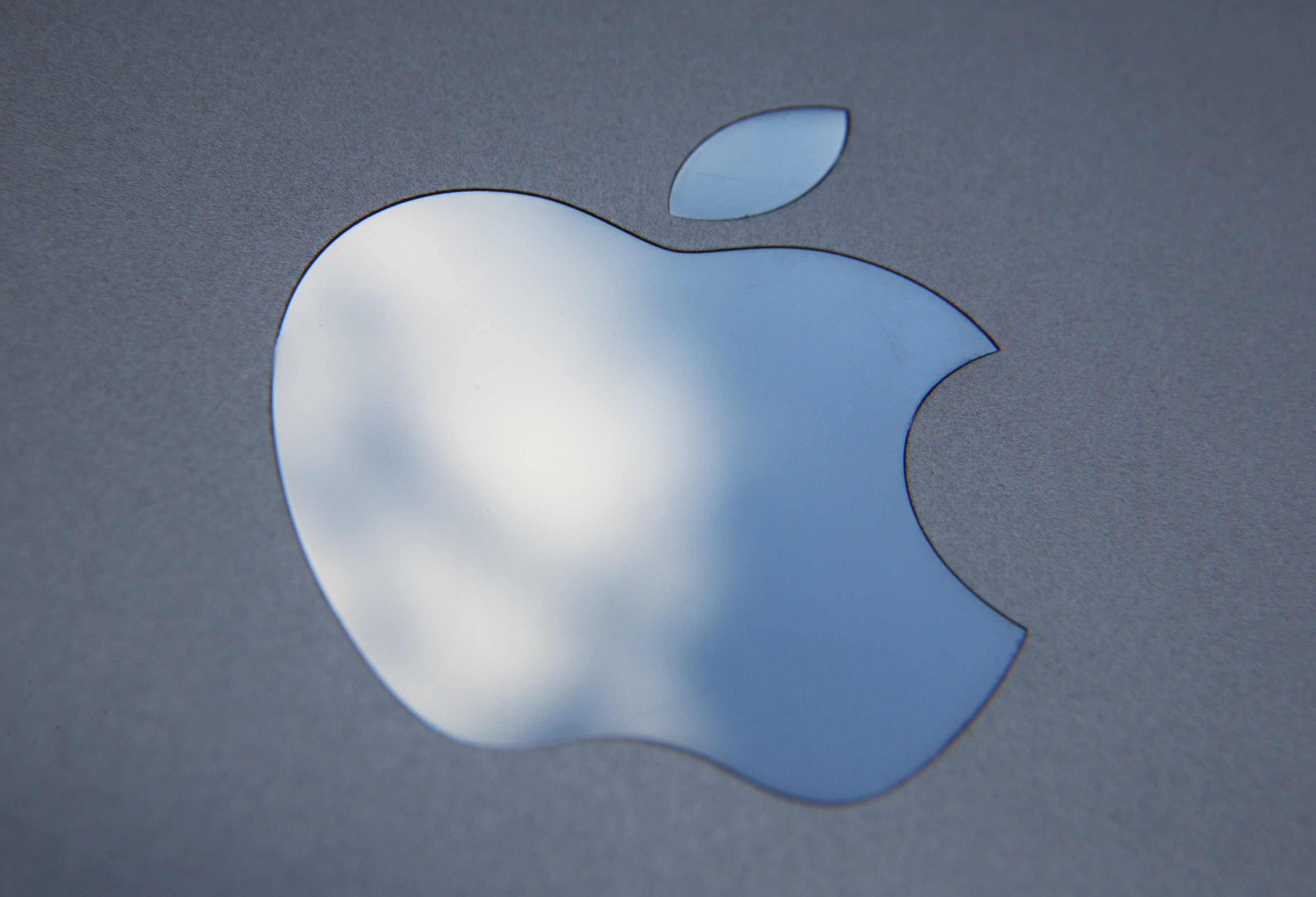 LONDON, ENGLAND - AUGUST 06: In this photo illustration the logo on an Apple iPad is seen on August 6, 2014 in London, England.  iPad maker Apple is selling fewer units than in the same quarter in 2013, it is reported.  (Photo illustration by Peter Macdiarmid/Getty Images)